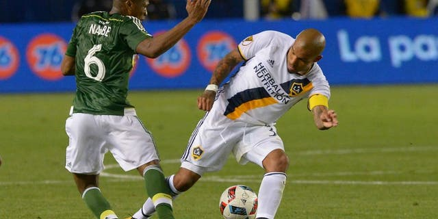 Apr 10, 2016; Carson, CA, USA; Los Angeles Galaxy midfielder Nigel de Jong (34) was given a yellow card for this collision with Portland Timbers midfielder Darlington Nagbe (6) in the second half of the game at StubHub Center. Portland Timbers midfielder Darlington Nagbe (6) left the game on a stretcher. Mandatory Credit: Jayne Kamin-Oncea-USA TODAY Sports