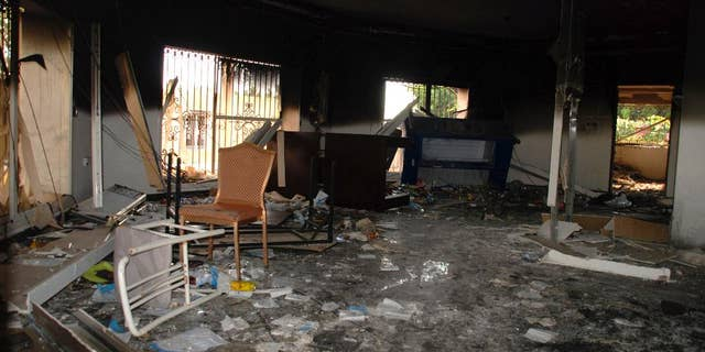 In this Sept. 12, 2012, file photo, glass, debris and overturned furniture are strewn inside a room in the gutted U.S. consulate in Benghazi, Libya, after an attack that killed four Americans, including Ambassador Chris Stevens.  (AP Photo/Ibrahim Alaguri, File)