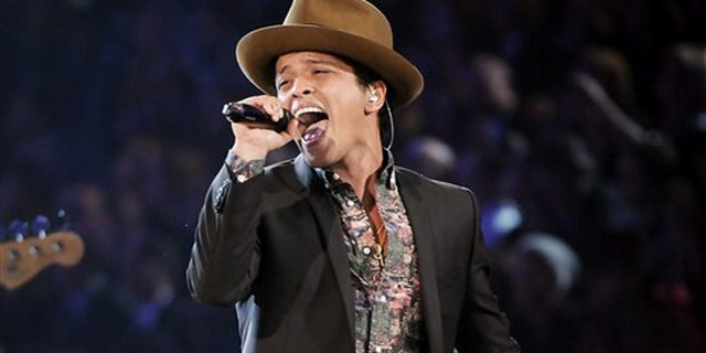 FILE - In this Nov. 7, 2012 file photo, Bruno Mars performs during the 2012 Victoria's Secret Fashion Show in New York. Mars will perform at this year's Super Bowl. (Photo by Evan Agostini/Invision/AP)