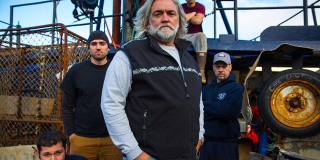Captain Wild Bill Wichrowski (center) and his crew.