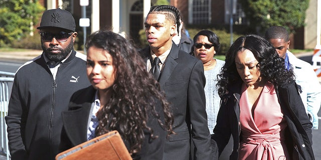 DeAndre Harris, second from right, enters the Charlottesville District Court in Virginia ahead of his trial on Friday.