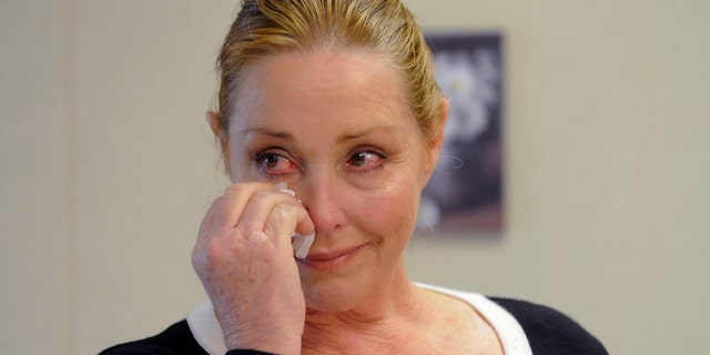 Debra Tate, sister of slain actress Sharon Tate, reacts after convicted mass murderer Charles Manson was denied parole at his 12th parole hearing for the 1969 Tate-Labianca murders, April 11, 2012.