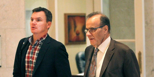 Major League Baseball executive Joe Torre, right, and Boston Red Sox general manager Ben Cherington talk in the hallway at the annual general managers meeting Tuesday, Nov. 12, 2013, in Orlando, Fla. (AP Photo/Reinhold Matay)
