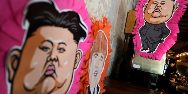 """Caricature piñata decorate the side of Mexican restaurant Lucha Loco, which wants to """"make tacos great again."""""""