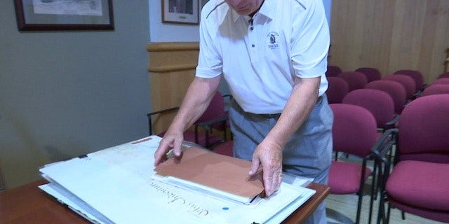 James Reis, 73, shows Fox News parts of his expansive deed collection.