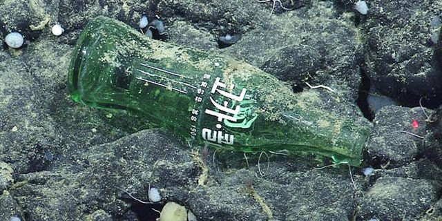 A Coke bottle from Asia found at Davidson Seamount, over a mile below the surface of the ocean