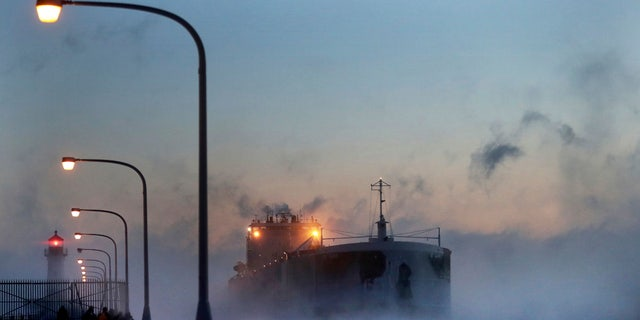 Steam rises from Lake Superior as the ship St. Clair comes to harbor.