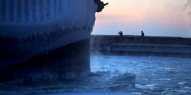 Steam rises from Lake Superior as the ship St. Clair comes to harbor during some of the coldest temperatures of the year.