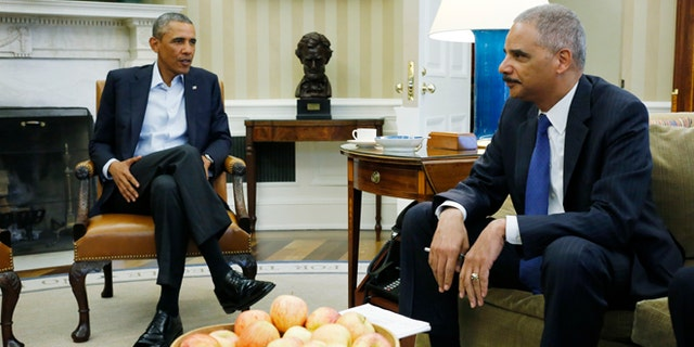 President Barack Obama meets with Attorney General Eric Holder (AP Photo/Charles Dharapak)
