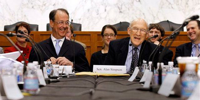 Debt commission co-chairmen former Wyoming Sen. Alan Simpson, right, and Erskine Bowles took part in a meeting on Capitol Hill in Washington, Wednesday, Dec. 1, 2010.