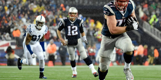 File photo - Jan 18, 2015, New England Patriots tackle Nate Solder (77) catches a pass from quarterback Tom Brady (12) and runs for a touchdown against the Indianapolis Colts in the third quarter in the AFC Championship Game at Gillette Stadium. (Robert Deutsch-USA TODAY Sport)
