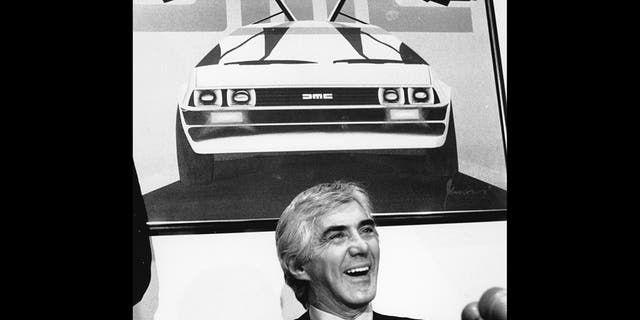 John Z. DeLorean answers reporters' questions at his news conference in New York on Feb. 19, 1982. (AP Photo/Marty Lederhandler)