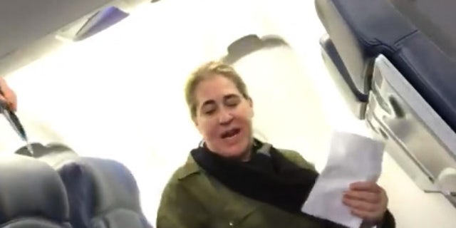 "Rundell filmed the woman telling the flight attendant that she ""may not have a job tomorrow."""