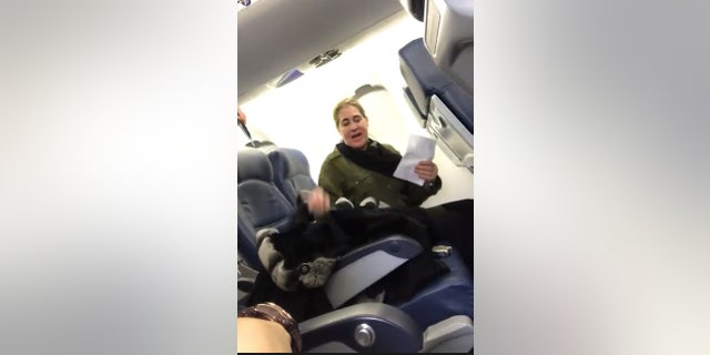 """Rundell filmed the woman telling the flight attendant that she """"may not have a job tomorrow."""""""