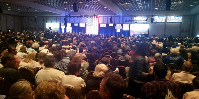 Thousands of people gather at the Paris casino in Las Vegas for the Nevada State Democratic Convention on Saturday, May 14, 2016. They are picking delegates to send to the national convention in July. (AP Photo/Michelle Rindels)