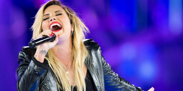 Demi Lovato performs during We Day in Toronto, on Friday Sept. 20, 2013.