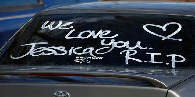 Feb. 7, 2015: Message covers the back window of a car parked by a mourner of Jessica Hernandez.