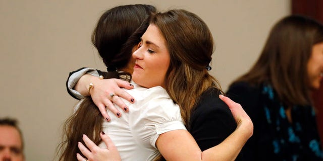 Rachael Denhollander, left, hugs Sterling Reithman, after Dr. Larry Nassar appeared in court for a plea hearing in Lansing, Mich., Wednesday, Nov. 22, 2017. Nasser, a sports doctor accused of molesting girls while working for USA Gymnastics and Michigan State University pleaded, guilty to multiple charges of sexual assault and will face at least 25 years in prison.