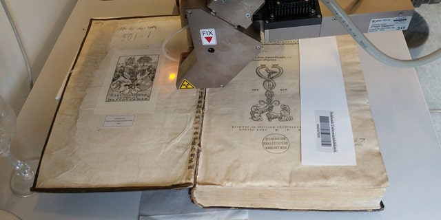 Scientists were looking for fragments of medieval manuscripts used to bind the books when they discovered the arsenic