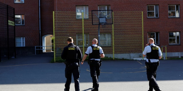 """Police patrol the grounds in Mjolnerparken, a housing estate that features on the Danish government's """"Ghetto List"""", in Copenhagen, Denmark, May 2, 2018."""