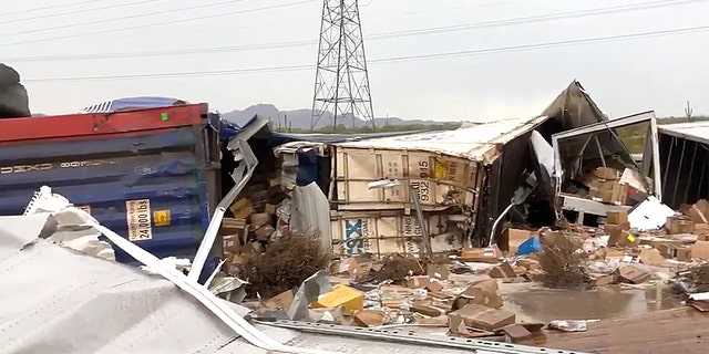 Debris on the side of an Arizona interstate after a freight train derailed after hitting floodwaters over the tracks.