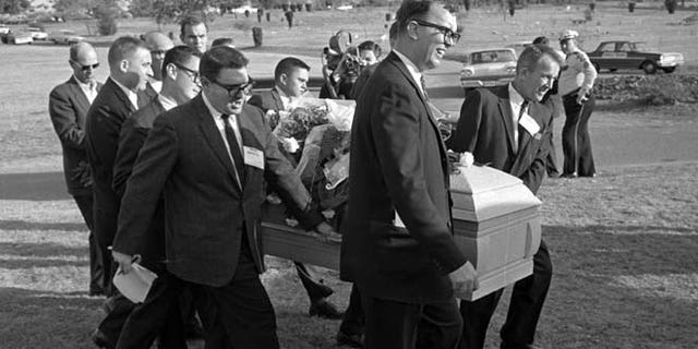 This file photo shows reporters that were enlisted to act as pall bearers at the interment of Lee Harvey Oswald at the Shannon Rose Hill Cemetery in Fort Worth, Texas.