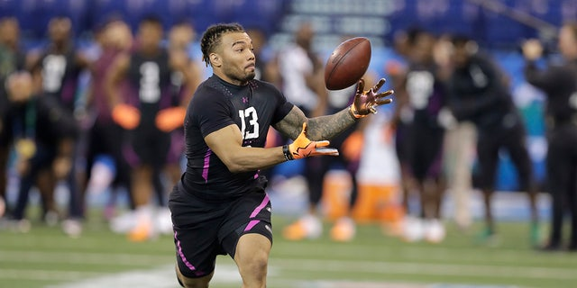 LSU running back Derrius Guice runs a drill during the NFL football scouting combine, Friday, March 2, 2018, in Indianapolis.
