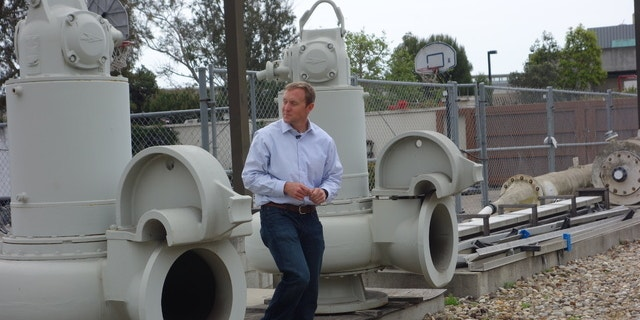 Joshua Haggmark, interim resources manager for Santa Barbara, Calif., looks at equipment that was brought up from the ocean floor after the city shut down its desalination plant more than two decades ago. (AP)