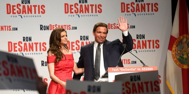 Florida Republican gubernatorial candidate Ron DeSantis, right, waves to supporters with his wife, Casey, at an election party after winning the Republican primary, Tuesday, Aug. 28, 2018, in Orlando, Fla. (AP Photo/Phelan M. Ebenhack)