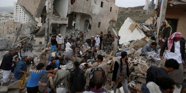 People search under rubble of a house destroyed by a Saudi-led air strike in Sanaa, Yemen, August 25, 2017.