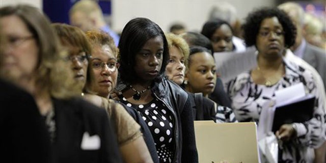 In this Aug. 25 photo, job seekers attend a job fair in Southfield, Mich. (AP Photo)