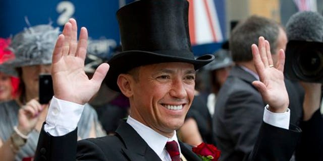 June 20, 2012:  In this photo Italian jockey Frankie Dettori poses for the cameras on the second day of Royal Ascot horse race meeting at Ascot, England.