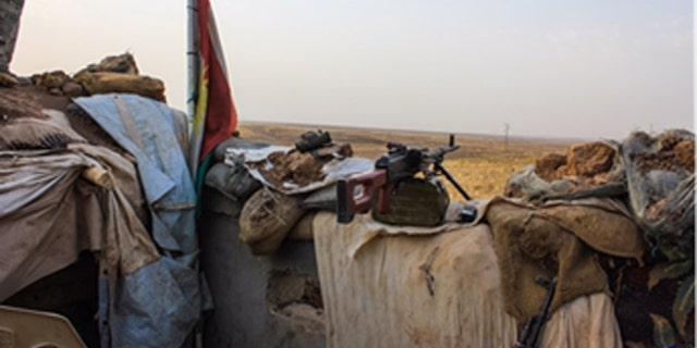 The secretive Kurdish force keeps watch over the no-man's land surrounding Mosul.
