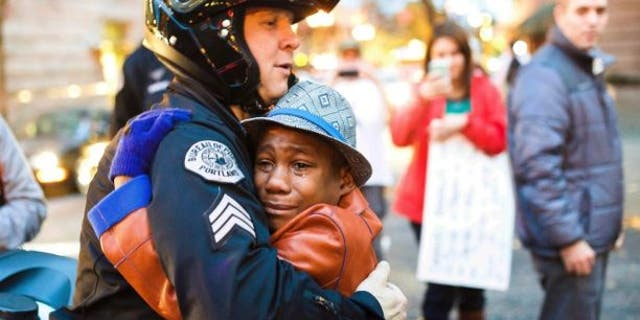 Devonte Hart, who was then 12, was photographed at a rally in Portland, Ore. in November 2014.
