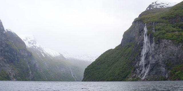 Seven Sisters waterfall and granite walls of Geirangerfjord.