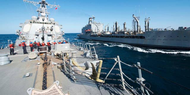 Dec. 24, 2015: Guided-missile destroyer USS Bulkeley participates in a replenishment-at-sea with fleet replenishment oiler USNS John Lenthall in the Gulf of Oman. (Mass Communication Specialist 2nd Class M. J. Lieberknecht/ U.S. Navy via AP)