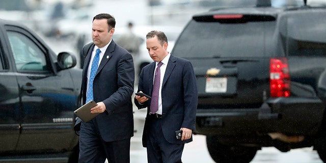 White House Director of Social Media Dan Scavino, left, walks with former White House Chief of Staff Reince Priebus steps off Air Force One as they arrive Friday, July 28, 2017, at Andrews Air Force Base, Md. Trump says Homeland Secretary John Kelly is his new White House chief of staff. (AP Photo/Alex Brandon)