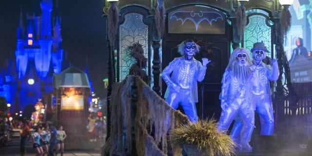 Haunted Mansion characters come to play during the parade.
