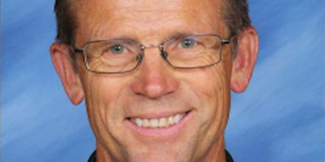 Junior high teacher Robert Crosland faces charge for allegedly feeding a puppy to a snapping turtle in front of students.