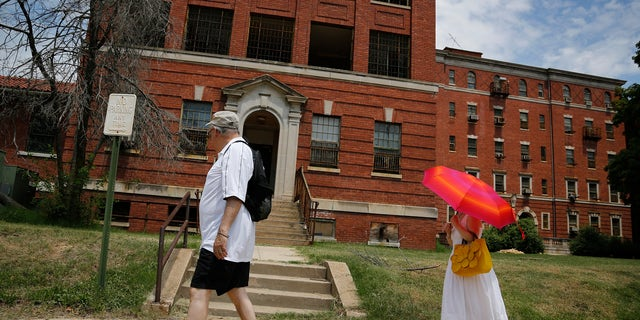 FILE: Visitors view the abandoned buildings on the grounds of the east campus of the historic St. Elizabeth's Hospital in Washington.