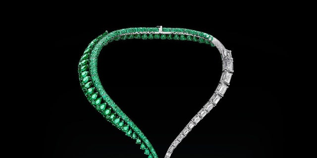 In this image released on Thursday, Sept. 28, 2017, a diamond necklace featuring a 163-carat flawless emerald stone, the largest of its kind ever to be put up for auction, has been unveiled in Hong Kong today. The finished piece, named The Art of de Grisogono will be presented in a series of public viewings around the world before it goes up for an auction at Christie's in Geneva on November