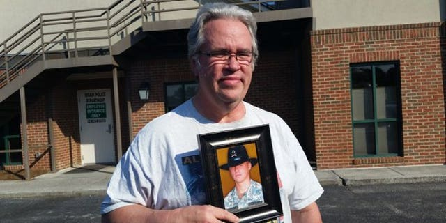 Tommy Dingler is seen holding a photo of his son, Joshua, who was 19 years old when he died while serving in Iraq.