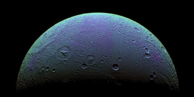 This view highlights tectonic faults and craters on Saturn's moon, Dione, an icy world that has undoubtedly experienced geologic activity since its formation. It is based on images from the the Cassini spacecraft taken on Dec. 24, 2005.
