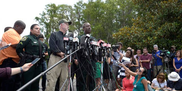 June 15: Nick Wiley, executive director of the Florida Fish & Wildlife Conservation Commission, left, and Orange County Sheriff Jerry Demings answer questions from reporters during a news conference.