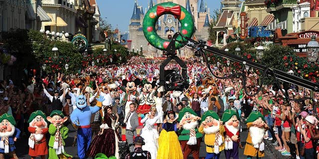 (Dec. 7, 2013): Joined by hundreds of Disney characters and performers, Emmy Award-winning actor Neil Patrick Harris tapes a musical number Dec. 7, 2013 for the Disney Parks Christmas Day Parade TV special at the Magic Kingdom park at Walt Disney World Resort in Lake Buena Vista, Fla. In addition to performing, Harris is one of the hosts of the annual holiday special.  The 30th annual holiday telecast airs December 25 on ABC-TV. The show also will air in Canada on CBC Network, and across the globe on the American Forces Network. (Mark Ashman, photographer)