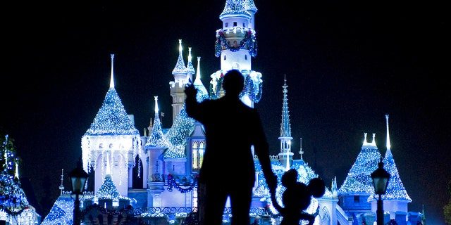 """Nov. 20, 209: Sleeping Beauty's Castle in winter dress with the iconic """"Partners"""" statue featuring images of Walt Disney and Mickey Mouse in the foreground, at Disneyland in Anaheim, Calif."""