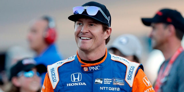 """FILE - In this Saturday, April 7, 2018, file photo, driver Scott Dixon smiles before the IndyCar auto race at Phoenix International Raceway in Avondale, Ariz. Dixon will be the latest IndyCar driver to enter the realm of reality TV when he auditions in Indianapolis next week for """"American Ninja Warrior. (AP Photo/Rick Scuteri, File)"""