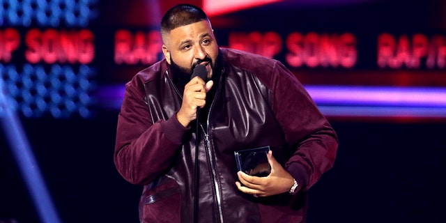 """FILE - In this Sunday, Nov. 19, 2017, file photo, DJ Khaled accepts the award for favorite song rap/hip-hop for """"I'm the One"""" at the American Music Awards at the Microsoft Theater in Los Angeles. Weight Watchers International climbed after it struck a deal with producer and recording artist DJ Khaled, who will represent the brand to millions of follows on Snapchat, Twitter, Instagram and Facebook. (Photo by Matt Sayles/Invision/AP, File)"""