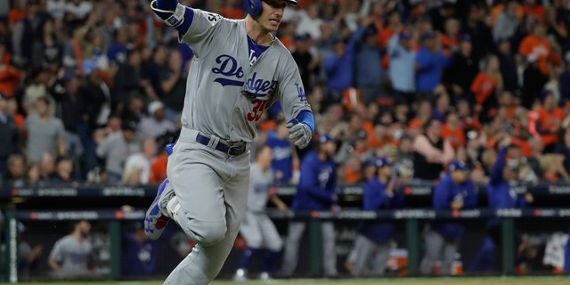 Los Angeles Dodgers' Cody Bellinger reacts after hitting an RBI double during the ninth inning of Game 4 of baseball's World Series against the Houston Astros Saturday, Oct. 28, 2017, in Houston. (AP Photo/David J. Phillip)