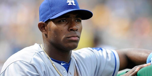 June 16, 2013: In this file photo, Los Angeles Dodgers right fielder Yasiel Puig watches from the in the dugout during the fourth inning of a baseball game against the Pittsburgh Pirates in Pittsburgh.